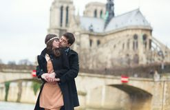Couple hugging in front of Notre-Dame Stock Photo