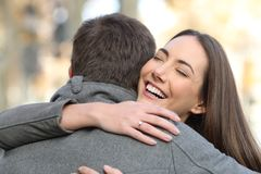 Couple hugging after happy proposal in the street stock images