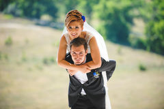 Couple Hugging and Having Fun. At sunny day Stock Photography