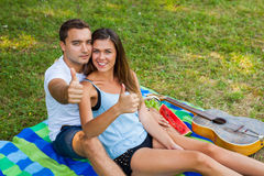 Couple hugging and having picnic in park Stock Images