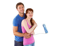 Couple hugging and holding brush Royalty Free Stock Image