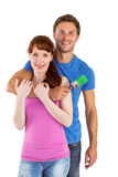 Couple hugging and holding brush Royalty Free Stock Photo