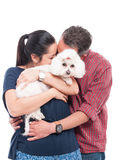 Couple hugging and holding their cute dog Stock Photography