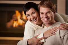 Couple hugging at home stock photo