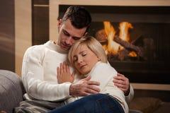 Couple hugging home Stock Photos