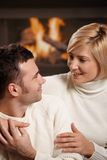 Couple hugging at home Royalty Free Stock Photography