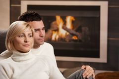 Couple hugging at home Stock Image