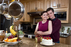 Couple Hugging In The Kitchen - Horizontal Stock Image