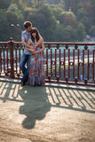 Couple hugging and kissing on a bridge Royalty Free Stock Image