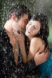 Couple hugging and kissing under a rain, in passion Stock Photos