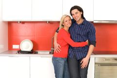 Couple hugging in kitchen Royalty Free Stock Images