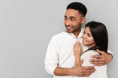 Couple hugging and looking away Royalty Free Stock Photo