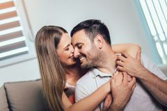 Couple hugging and looking at each other stock images