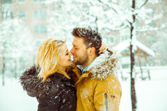 Couple hugging and looking into each other's eyes in the snow Royalty Free Stock Image