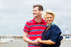 Couple hugging at marina pier Royalty Free Stock Images