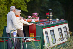 Couple hugging on narrow boat Stock Images