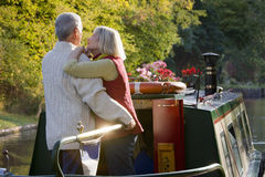 Couple hugging on narrow boat in canal Royalty Free Stock Photography