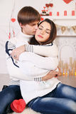 Couple hugging near a fireplace Stock Images
