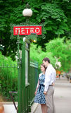 Couple is hugging near the metro station in Paris Stock Photos