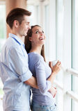 Couple hugging in new apartment Royalty Free Stock Image