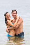 Couple hugging ocean. Beautiful young couple hugging in ocean Stock Photo