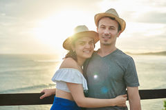 Couple hugging on ocean sunset background Stock Photography