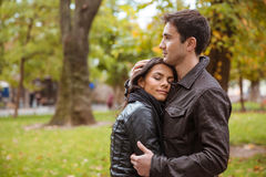 Couple hugging outdoors in park Royalty Free Stock Photos