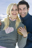 Couple hugging outdoors in snow Royalty Free Stock Photos