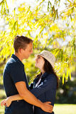 Couple hugging outdoors Stock Photos