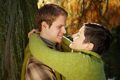 Couple hugging in park. Loving couple embracing in autumn park royalty free stock photos