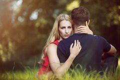 Couple hugging in park