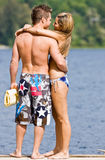 Couple hugging on pier Royalty Free Stock Photo