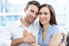 Couple hugging. Portrait of a smiling young couple hugging Stock Photography