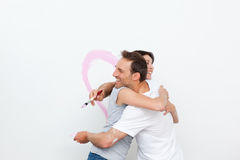 Couple hugging while renovating a bedroom Stock Image
