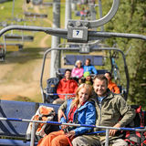 Couple hugging on romantic chairlift trip Royalty Free Stock Images