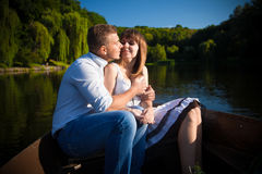 Couple hugging on rowing boat Stock Photos