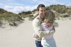 Couple Hugging On Sandy Beach Stock Images