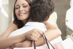 Couple Hugging Shopping Stock Photo
