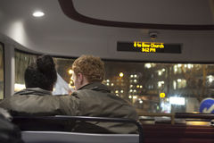 The couple, hugging, sitting on the bus in the front seat Stock Photos