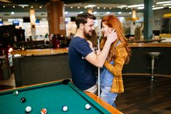 Couple hugging in snooker bar. On their date stock images