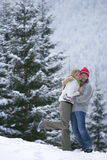 Couple hugging in snow on remote snowy hillside Stock Image