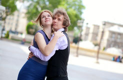 Couple hugging at the street Stock Image