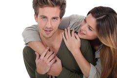 Couple hugging in studio Stock Images