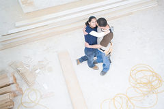 Couple hugging in their new home Stock Photography