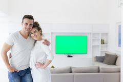 Couple hugging in their new home stock photo
