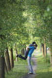 Couple Hugging On Tree Lined Path Royalty Free Stock Photography