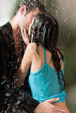 Couple hugging under a rain stock image