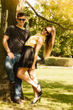Couple hugging under tree. Royalty Free Stock Images