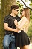 Couple hugging under tree. Royalty Free Stock Image