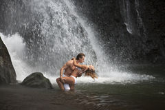 Couple Hugging Under Waterfalls Stock Photos